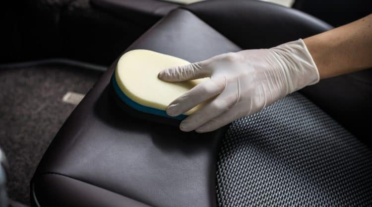 Cleaning Leather Seats with Sponge