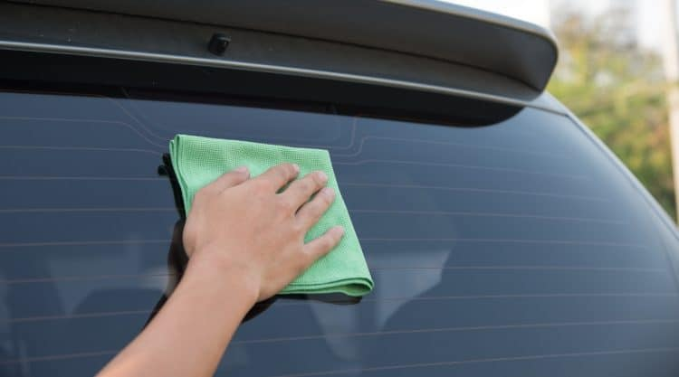 Person Cleaning Car Windows