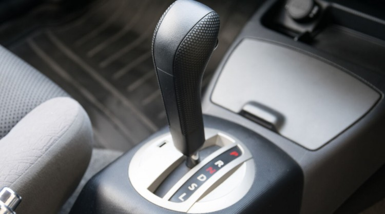 An automatic transmission gear knob with a neutral safety switch