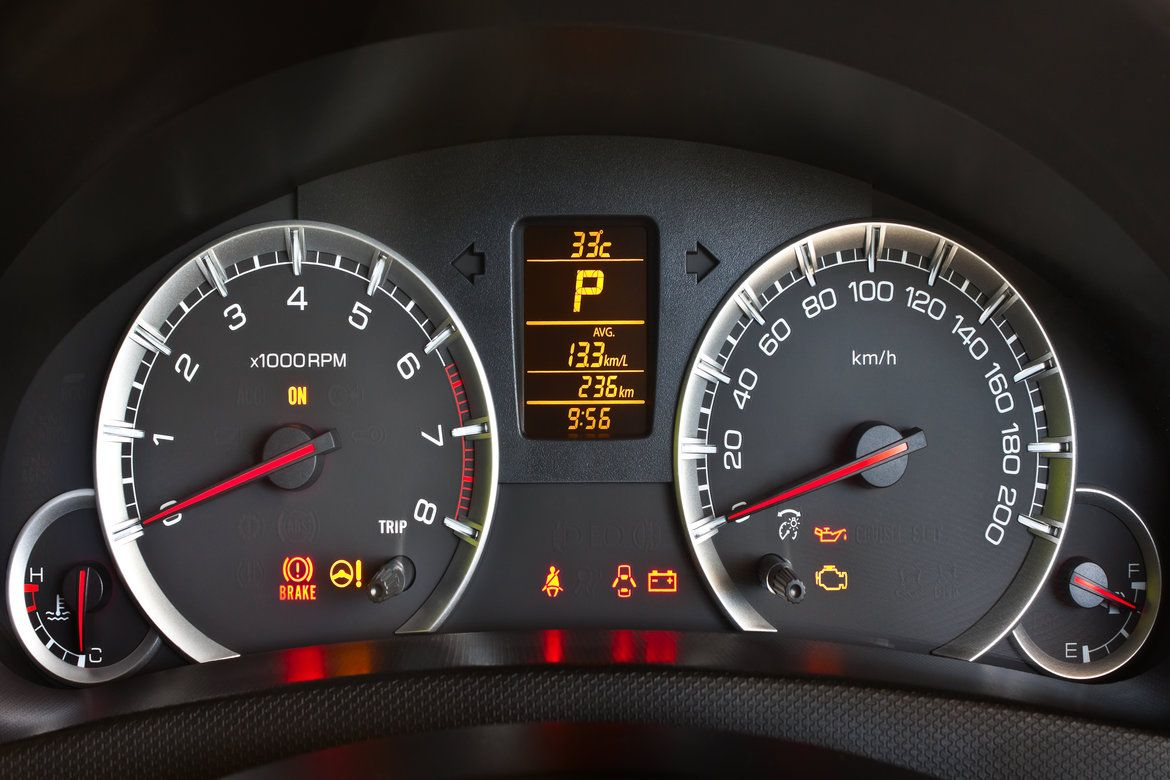 Car dashboard with reduced engine power light coming on