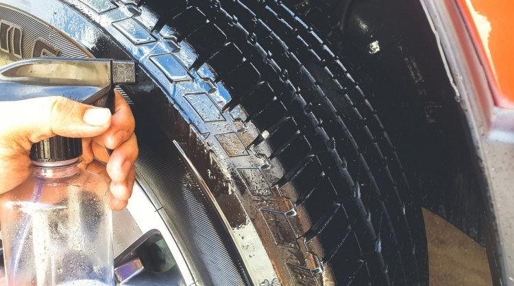 Tire Dressing Being Placed on Tire