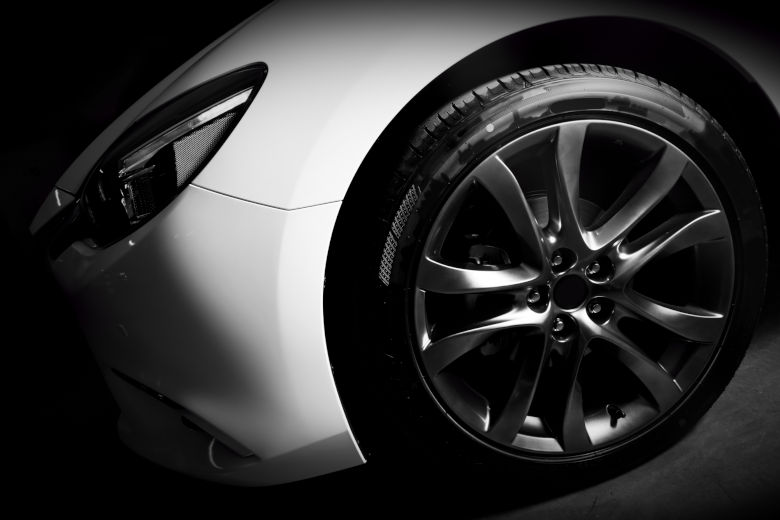 Close up of the wheel of a super car, showing the detailing and results of tire shine