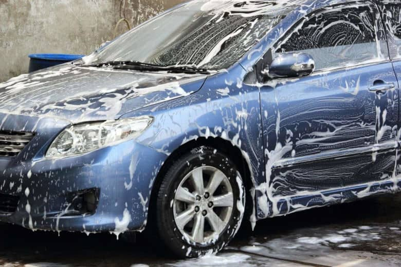 A dark blue ar covered in car wash soap