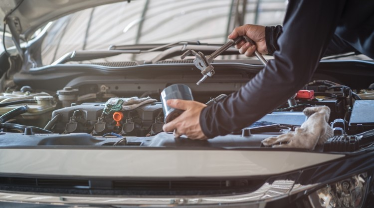 Changing Oil Filter With Wrench