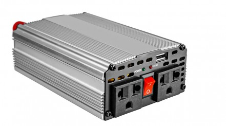 A car power inverter isolated on white, with AC sockets facing toward camera