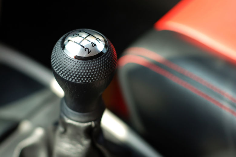 Close up of a shift knob in a sporty looking car