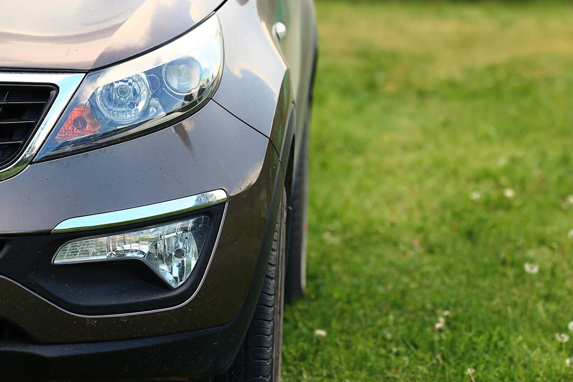 Picture showing headlights of a car parked on grass