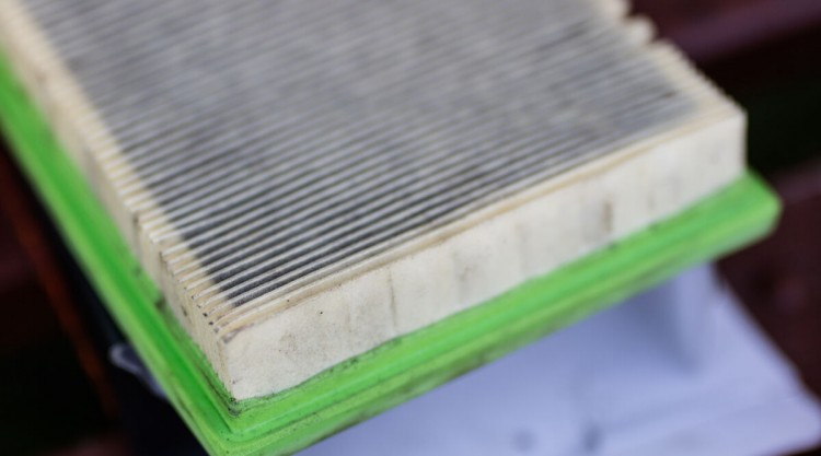 Close up on a dirty cabin air filter that needs to be replaced