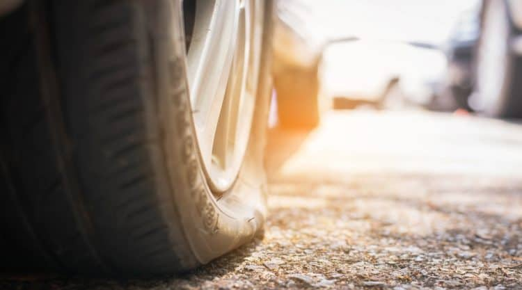 Car Driving on Flat Tire