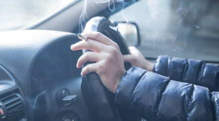 Person Smoking Inside Car Interior