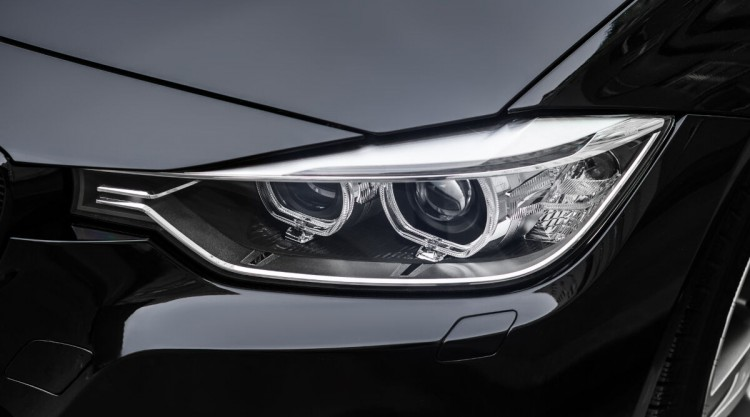 Luxury black car with beautiful headlights