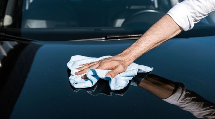 Man wiping his car