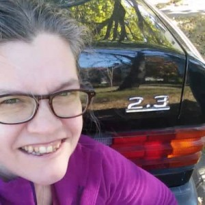 Jenny Jordan profile pic, with her black BMW in the background