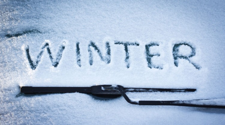 Close up of winter wiper blades, and the word
